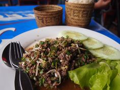 Lao food. Larp or Larb wth sticky rice. Laos. http://worldravelfamily.com