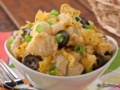 Taco Potato salad:  3 pounds white potatoes  2 cups mayonnaise  1 (1.25-ounce) package taco seasoning mix  1 cup shredded Cheddar cheese  1/2 cup sliced scallions (green onions)  1 (2.25-ounce) can sliced black olives, drained  1 cup coarsely crushed ranch-flavored tortilla chips