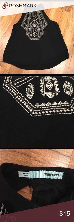 Tribal black halter Flowy in material, can easily fit a medium.             Great to wear with shorts, jeans, or leggings. Maurices Tops Tank Tops