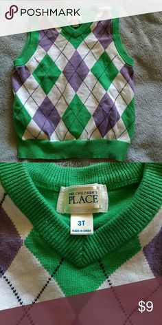 Children's Place sweater vest White sweater vest trimmed in green with purple navy blue and green Argyle design on it would be cute for a boy or a girl The Children's Place Jackets & Coats Vests