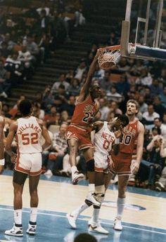 MJ dunks on Orlando Woolridge in New Jersey.