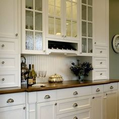 Buffet - traditional - kitchen - wine storage and glass cabinets work well together