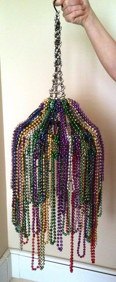 I made this Mardi Gra chandelier from my beads this year! :)  It's a hanging basket for flowers, upside down, with beads laced on different levels!