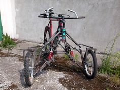 This is my prototype of reverse trike MTB bicycle. Front view. Suspension works grate and it really swing.  My weekend welding project with scrap bicycle parts.