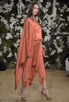 Beauty undercover:Bella meanwhile strutted out in a figure-hiding silk dress...