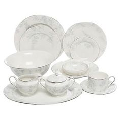 """30-Piece china dinnerware set with a floral motif.  Product: 4 Dinner plates4 Salad plates4 Appetizer plates1 Fruit bowl4 Cups4 Saucers1 Pasta bowl1 Serving bowl1 Tray1 Sugar bowl1 Creamer4 Accent platesConstruction Material: PorcelainColor: White and multiDimensions: Dinner plate: 10.88"""" Diameter eachSalad plate: 9"""" Diameter eachAppetizer plate: 6.5"""" DiameterFruit bowl: 5.5"""" DiameterCup: 3.25"""" H eachSaucer: 6"""" DiameterPasta bowl: 9"""" DiameterServing bowl: 4"""" H x 10.5"""" DiameterTray: 14"""" W x…"""