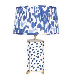 Perched on golden claw feet, this steel table lamp shows off a faceted body accented with a simple design in blue and white. A pleated, patterned cotton shade coordinates beautifully. Cool Lamps, Unique Lamps, Custom Shades, French Country Bedrooms, Bright Homes, Steel Table, Ikat Print, Lamp Shades, Floor Lamp