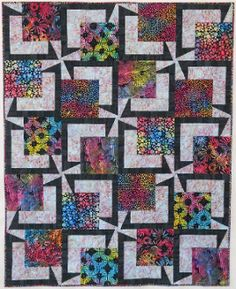 """BQ5 Quilt Pattern by Maple Island Quilts at KayeWood.com. Big off center focus with a pinwheel or accent splash. The pinwheels are a flat top diagonal which doesn't require matching of sharp points. Use one center fabric or many. The pattern includes 2 block sizes, 18"""" with a 12"""" center or 13.5"""" with a 9"""" center, perfect for pre-cuts. http://www.kayewood.com/BQ5-Quilt-Pattern-by-Maple-Island-Quilts-MIQ-BQ5.htm $9.50"""