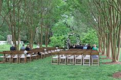Our natural wood folding chairs setup for a ceremony.