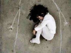 The little girl that lost her mother in the war. She went to the orphanage in order to survive. In the courtyard of the orphanage mother painted with chalk and curled in her lap, like when she was a fetus. Took off her shoes, as if he stepped something sacred, proving that love is the most sacred our site.