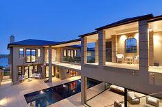 Contemporary house. Bridge over pool