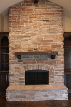 Custom stone fireplace in the living room.  To see more photos visit www.mckinneyhomesllc.com