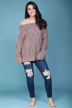 Off the shoulder, cable-knit, oversized sweater. Effortless and stylish winter fashion.