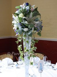 delicate blue flowers in a tall wedding centrepiece