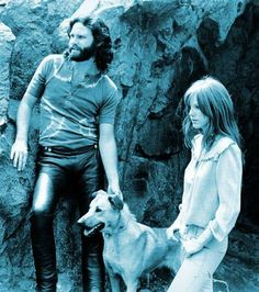 Jim Morrison and Pamela Courson with a doggy friend. (LIFE)