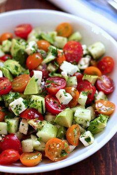 Ingrediets: 1½ cups of cherry tomatoes 1 cucumber - peeled and seeded then diced 1 avocado - diced 4 oz feta cheese - cubed 2 tbs minced red onion 1 handful parsley - minced - about 2 tbs 2 tbs olive oil 1 tbs red wine vinegar 8 twists of black pepper from a pepper mill