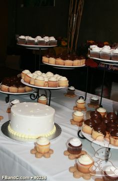 Wedding cupcake table set up...Notice the flower shaped cookie the cupcakes are sitting on ?!?!  They are peanut butter flavored dog biscuits !
