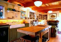 So much to love.  Wood island, dark cabinets, farm sink, open shelves, and tounge and groove ceiling.