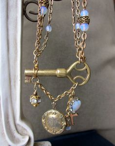 One of my first designs using the vintage key on its side.  The vintage opal style beads are lovely as they glow with the light.  One of a kind Repurposed Necklace by jryendesigns.etsy.com