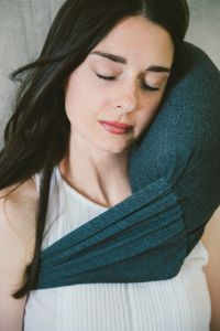 Travel Pillow - 40 Winks™ Travel. Functional simplicity. Soft Cotton Jersey Fabric. Weighs 10 oz. Made in California.  Use with our sachets of organic lavender to further escape into a land of zzz's... just breathe in & relax.  Patent No. D731,814