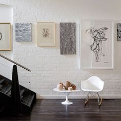 desiretoinspire.net LEVEL GALLERY- stagger art work at eye height, each level with the other.