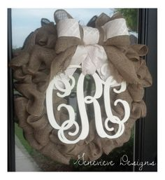 Burlap Wreath w/ Wood Monogram & Handmade Bow - Perfect for Chrismas, Weddings, New Babies, or Because You Love Monograms. $115.00, via Etsy.