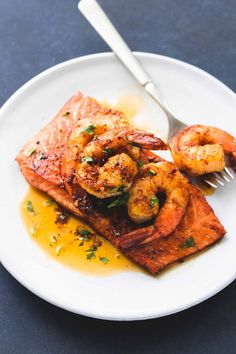 Cajun Salmon - Sweet and savory pan-seared salmon topped with sauteed shrimp in cajun butter sauce. Salmon New Orleans is a 30 minute meal your family will crave.