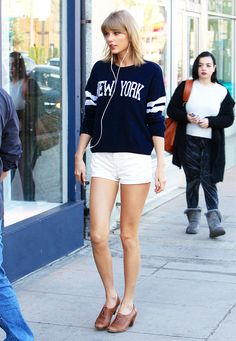 Taylor Swift in a sweater, shorts, and heeled oxfords