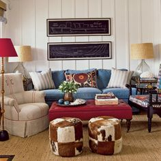 The chair upholstery and the hide poufs