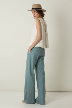 casual. lovely linen pants. great color. love the top too. and the hat.
