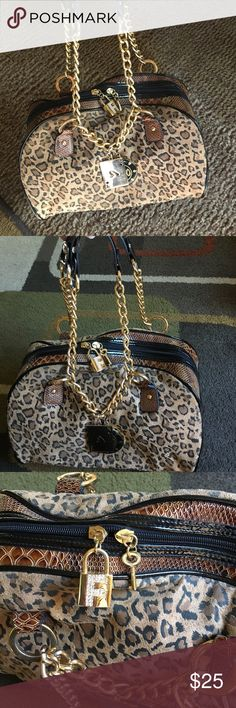"""Fetish by Eve bag🍁 Cheetah print with reptile design sides🍁 Gold hardware🍁 lock and key on zipper closure's actually work🍁 no tears no stains🍁handle drop approx 8.5"""" 🍁bag measures approx 11.5"""" across by approx 6.5"""" tall🍁bottom measures approx 6"""" wide Fetish by Eve Bags"""