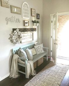 For my entry way bench....hooks above with some pics, pillows across top with baskets below