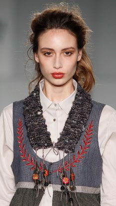Details - both in the dress and also hanging from the knitted collar.