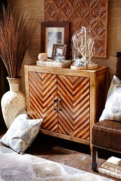 Hindu philosophy teaches that all is illusion (maya)—and Pier 1's fool-the-eye Kadhi Cabinet is a prime example. Handcrafted from native Indian hardwoods, each piece features a bold chevron design that lends a 3-D appearance to door fronts. But inside, two drawers and a shelf provide very real storage space.