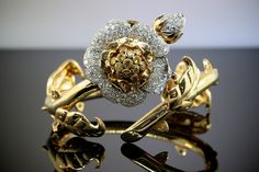 A Yellow Diamond & Diamond Foliate Watch & Scatter Clips Set by Paul Flato - Lucas Rarities
