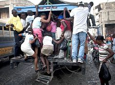 Do not be tardy, got to make it anyway you can. Public transportation in Haiti is for the fittest.