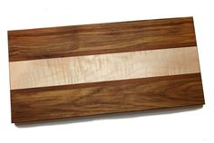 This handcrafted table platter is made from canary, goncalo alves, and figured* maple hardwoods. It ...