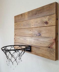 Wall decor with functionality! This rustic style reclaimed wood basketball hoop…
