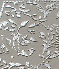 Raised plaster wall stencil.