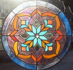 Stained glass window panel...but I think the colours and pattern would look nice also in mosaics. #StainedGlassMandala