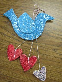 2nd grade American folk art ceramic bird with hearts; lesson by art teacher: Susan Joe