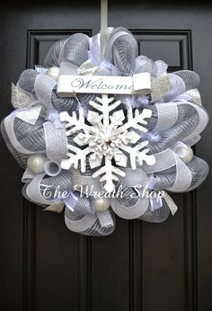 A Christmas or Winter Wreath on Silver and White Deco Mesh with coordinating ribbons and ornaments.
