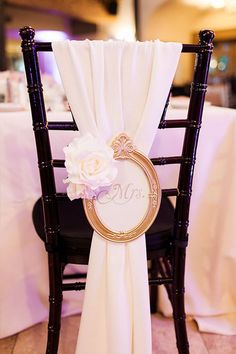 Wedding chair decor idea. Vintage frame with Mrs. written in the center.