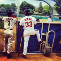 Hall of Famers Ozzie Smith and Eddie Murray watch batting practice before the Hall of Fame Classic game in Cooperstown, NY.