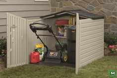 Inside the garage, mower cupboard with shelf above for catcher or fuel and accessories.