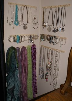 Organizing Jewelry.  Yesterday I bought a sewing thread spool holder, pulled the bars off and hung them up in a corner in my bedroom... ta da, instant organization!  .  I did the entire thing for less than ten bucks.