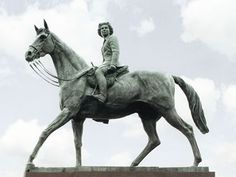 Equestrian sculpture of   HM The Queen   The Great Park, Windsor, commissioned by The Crown Estate to celebrate Her Majesty's Golden Jubilee, unveiled by HM The Queen in 2003, bronze life-size and a half.
