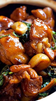 Taiwanese 3-cup chicken ~ delicious comfort food made with ginger, garlic, chicken and soy sauce, with basil leaves