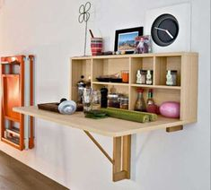 Want to do something like this in our guest room/studio space; the table folds down when not in use. Great way to create extra horizontal space for drawing, crafts, etc.