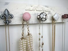 DIY jewelery hanger.... I might do this and use it as coat hangers